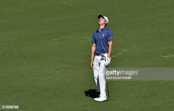 US golfer Justin Thomas reacts afte playing a shot on the 2nd hole during Round 1 of the 80th Masters Golf Tournament at the Augusta National Golf...