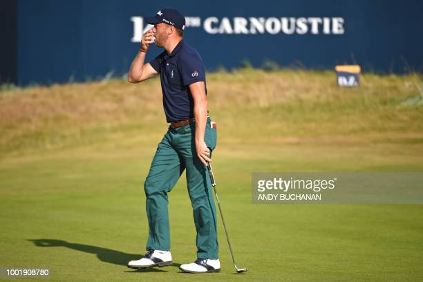 Golfer Justin Thomas reacts after narrowly missing a long putt on the 18th green during his first round on day one of The 147th Open golf...