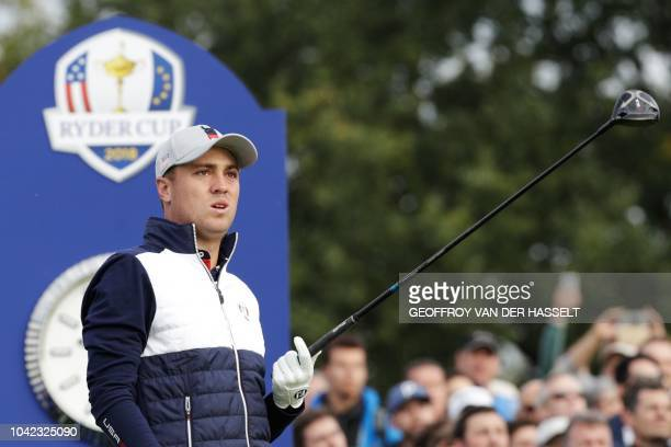 Golfer Justin Thomas reacts as he plays a tee shot during his fourball match on the first day of the 42nd Ryder Cup at Le Golf National Course at...