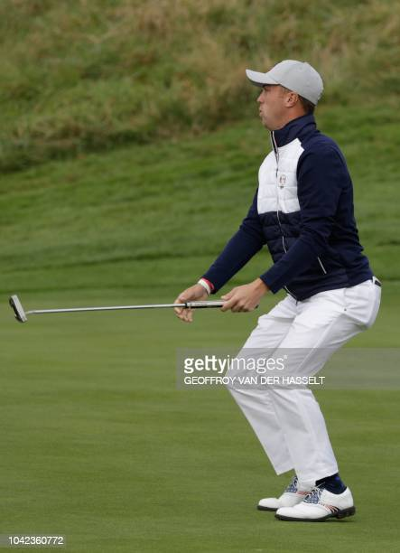 US golfer Justin Thomas reacts during his fourball match on the first day of the 42nd Ryder Cup at Le Golf National Course at SaintQuentinenYvelines...