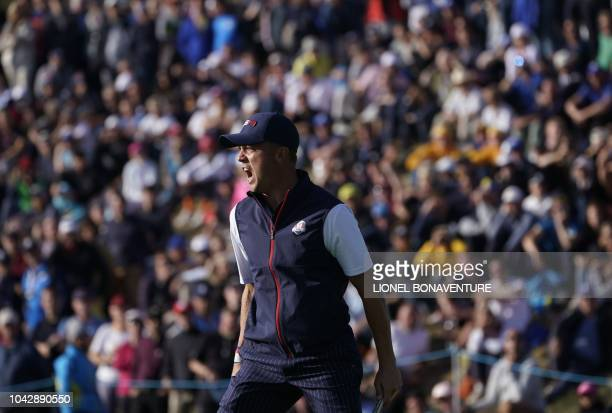 US golfer Justin Thomas reacts during his foursomes match on the second day of the 42nd Ryder Cup at Le Golf National Course at...
