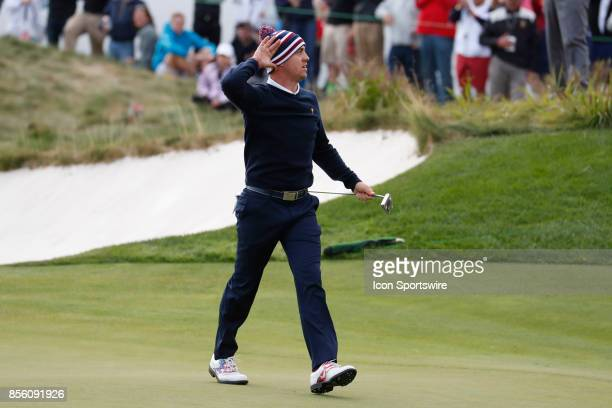 USA golfer Justin Thomas reacts to making a long birdie putt on the 14th hole during the third round of the Presidents Cup at Liberty National Golf...