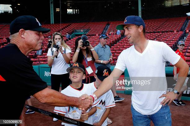 5ee554b6826 Golfer Justin Thomas shakes hands with Florida Marlins coach Dan Treanor  during a tour of Fenway