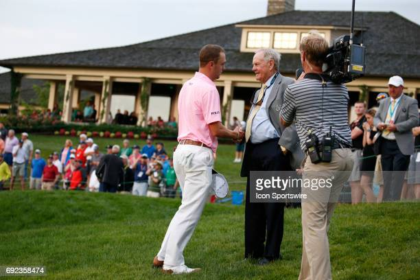 PGA golfer Justin Thomas shakes hands with Jack Nicklaus after completing his round on the 18th hole during the Memorial Tournament Final Round at...