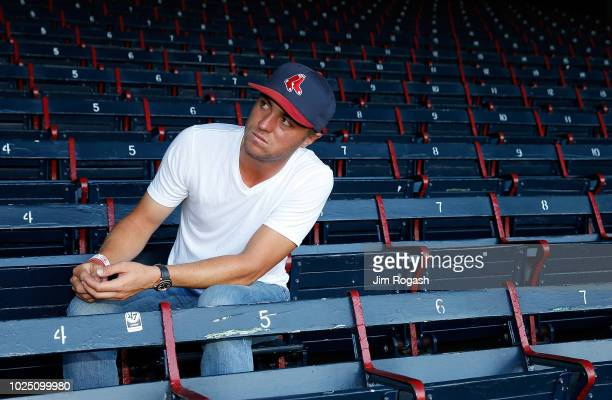 Golfer Justin Thomas sits in the grandstand during a tour of Fenway Park before a game between the Boston Red Sox and the Miami Marlins on August 29,...