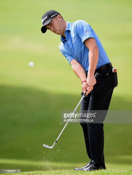 US golfer Justin Thomas strikes the ball during the third round of the PGA World Golf Championship at Chapultepec's Golf Club in Mexico City on...