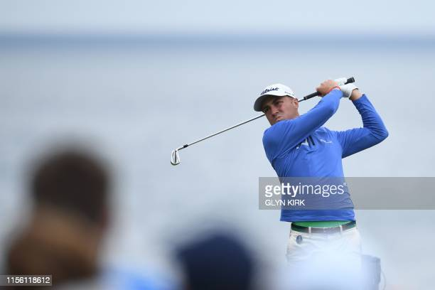 Golfer Justin Thomas tees off from the 6th hole during a practice session at The 148th Open golf Championship at Royal Portrush golf club in Northern...