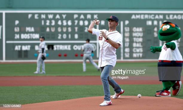 Golfer Justin Thomas throws out the first pitch at Fenway Park before a game between the Boston Red Sox and the Miami Marlins on August 29, 2018 in...