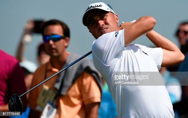 US golfer Justin Thomas watches his drive from the 15th tee during a practice round at Royal Birkdale golf course near Southport in north west...