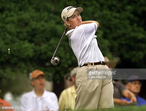 Golfer Karrie Webb of Australia hits her tee shot on the 9th hole 01 June 2001 during the second round of the US Women's Open at Pine Needles Lodge...