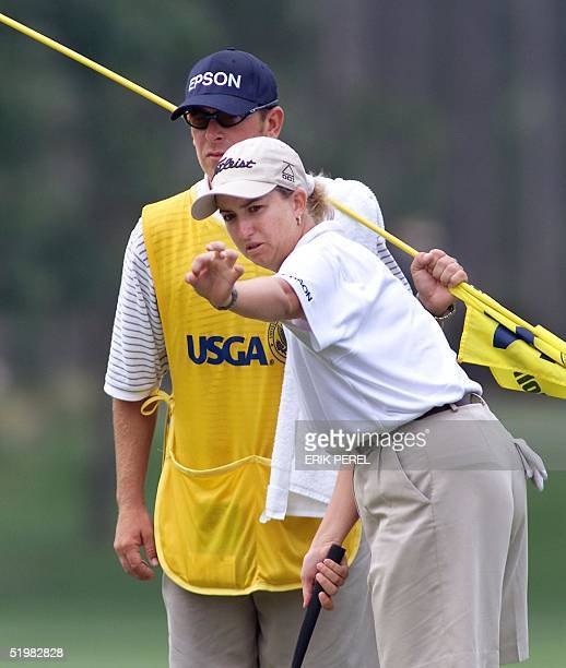 Golfer Karrie Webb of Australia lines up a putt with the assistance of her caddie Mike Patterson on the 14th hole 1 June 2001 during the second round...