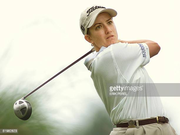 Golfer Karrie Webb of Australia watches her tee shot on the 10th hole 1 June 2001 during the second round of the US Women's Open at the Pine Needles...