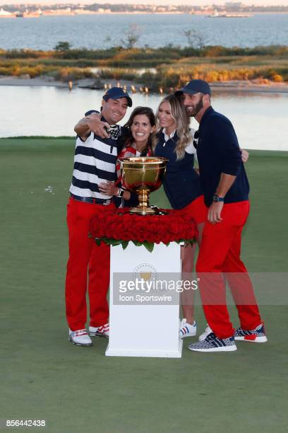 USA golfer Kevin Kisner takes a selfie with his wife Paulina Gretsky and Dustin Johnson after the final round of the Presidents Cup at Liberty...