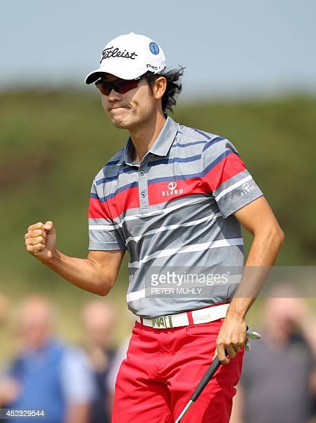 Golfer Kevin Na celebrates making his birdie putt on the 5th green during his second round, on day two of the 2014 British Open Golf Championship at...