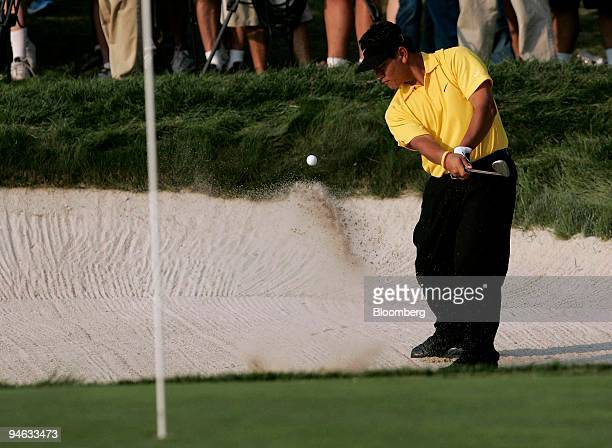 Golfer KJ Choi hits out of a bunker on the 18th hole during the third round of the Barclays Classic golf tournament at Westchester Country Club in...