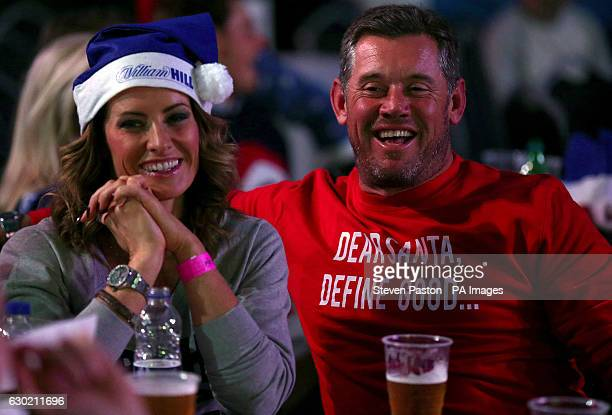 Golfer Lee Westwood with girlfriend Helen Storey during day four of the William Hill World Darts Championship at Alexandra Palace London