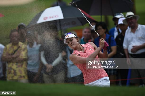 US golfer Lexi Thompson hits the ball out of a bunker during the Honda LPGA golf tournament at the Siam Country Club in the coastal Thai province of...