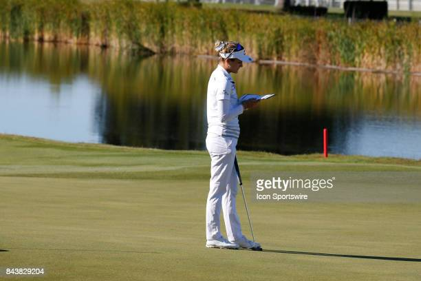 LPGA golfer Lexi Thompson looks at her yardage book on the 16th hole during the first round of the Indy Women In Tech on September 7 2017 at the...