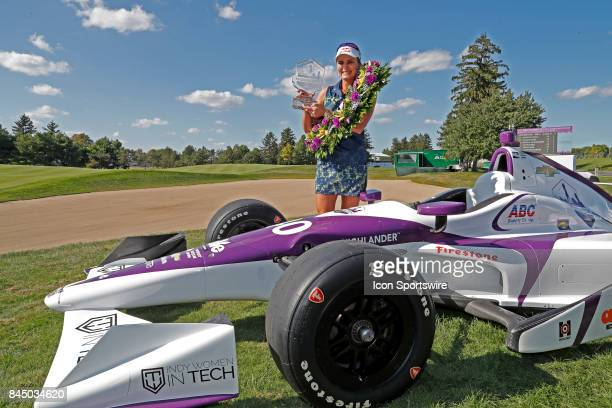 LPGA golfer Lexi Thompson poses with the trophy wearing an Indy 500 winners wreath and posing next to an Indy Car after winning on the final round of...