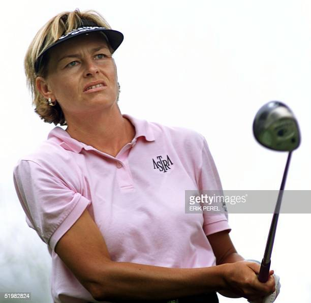 Golfer Liselotte Neumann of Sweden watches her tee shot on the 10th hole 1 June 2001 during the second round of the US Women's Open at the Pine...