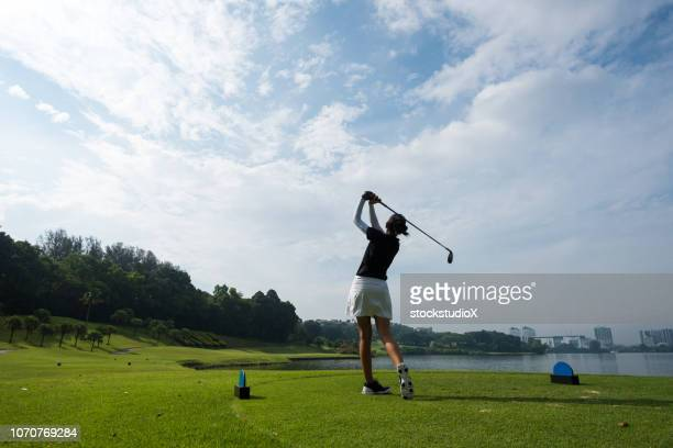 golfer making the chip - golfer stock pictures, royalty-free photos & images