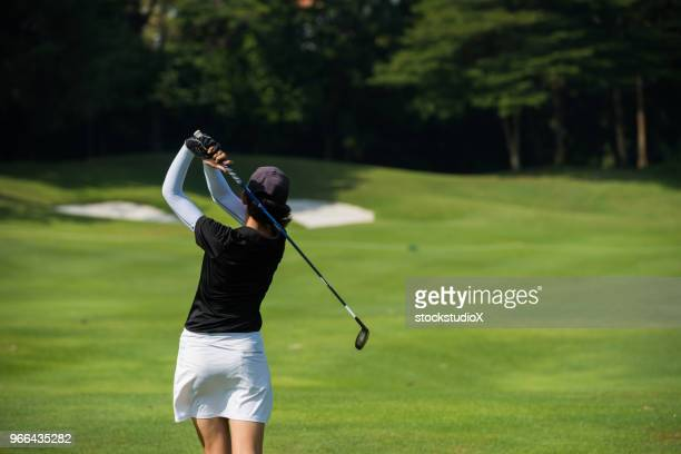 golfer making the chip - golf stock pictures, royalty-free photos & images