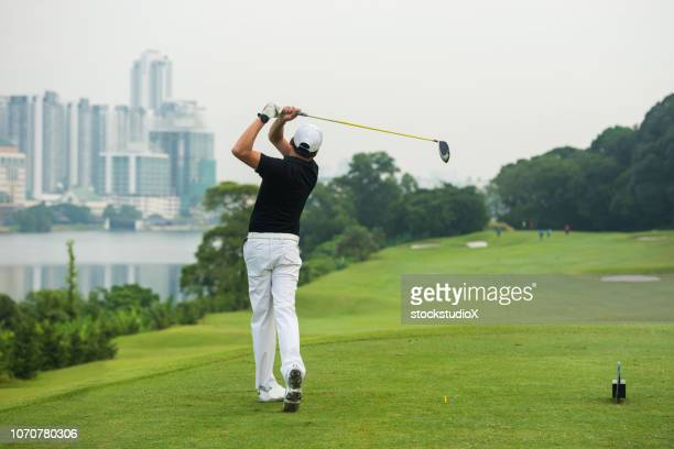 golfer making the drive - golfer stock pictures, royalty-free photos & images