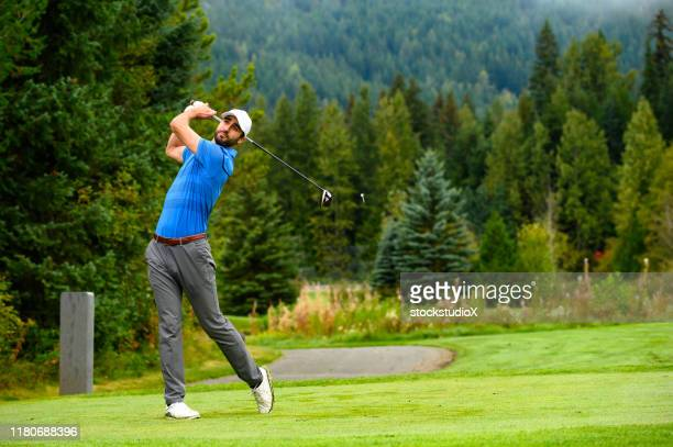golfer making the drive - drive ball sports stock pictures, royalty-free photos & images