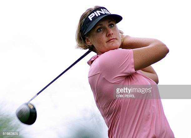 Golfer Maria Hjorth of Sweden watches her tee shot on the 10th hole 1 June 2001 during the second round of the US Women's Open at the Pine Needles...