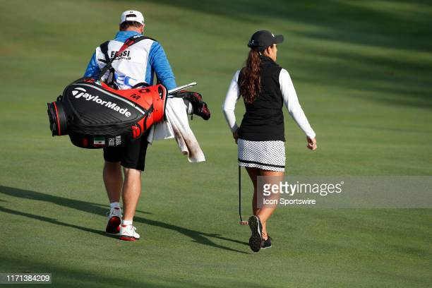 LPGA golfer MariaFassi and her caddie walk the first hole during the first round of the Indy Women In Tech on September 26 at the Brickyard Crossing...
