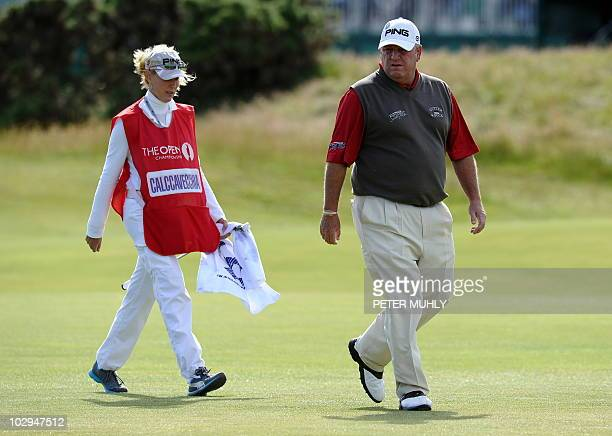 US golfer Mark Calcavecchia and his caddie wife Brenda walk to the 1st Green during the third round on day three of the British Open Golf...