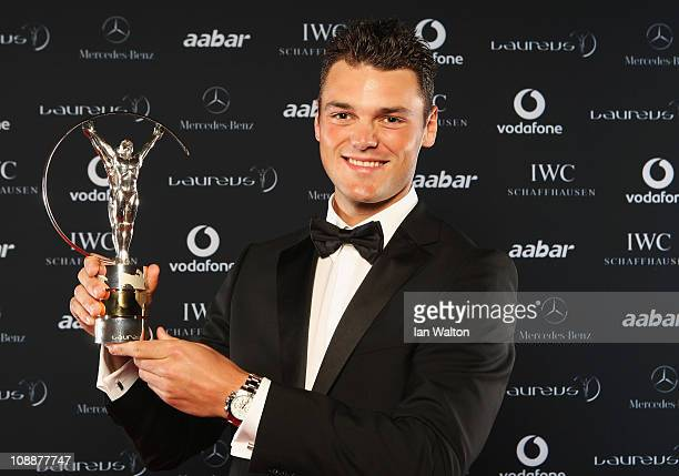 """Golfer Martin Kaymer of Germany poses with his award for """"Laureus World Breakthrough of the Year"""" in the winners studio at the 2011 Laureus World..."""