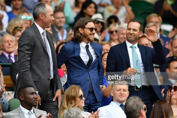 US golfer Matt Kouchar English golfer Tommy Fleetwood and Spanish golfer Sergio Garcia takes their seat in the Royal box on Centre Court Spain's...