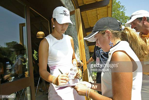 US golfer Michelle Wie 14 signs an autograph 22 July 2004 at the Evian Masters golf tournament in Evian AFP PHOTO/ FRED DUFOUR