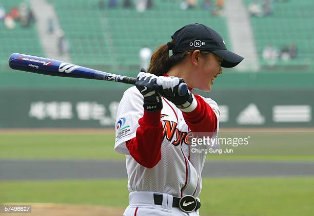 Golfer Michelle Wie reacts during the ceremonial batting for a baseball game between the Doosan Bears and SK Wyverns on April 30, 2006 in Incheon,...
