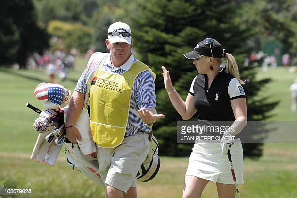 US golfer Morgan Pressel celebrates with her caddie after an eagle during the Evian Masters Golf Tournament on July 25 2010 in EvianlesBains French...