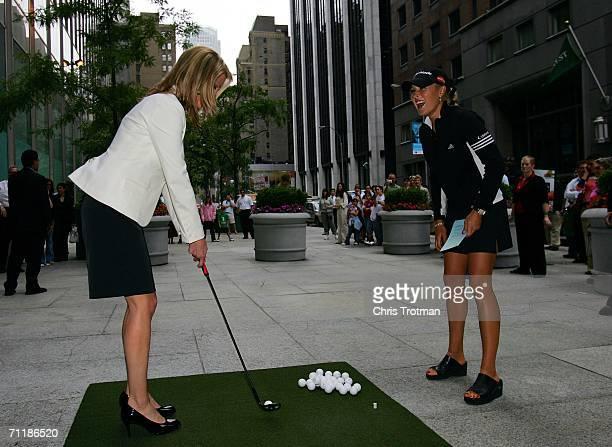 Golfer Natalie Gulbis of the LPGA Tour watches Juliet Huddy of Fox's Dayside show hit golf balls to promote the HSBC Womens World Match Play...