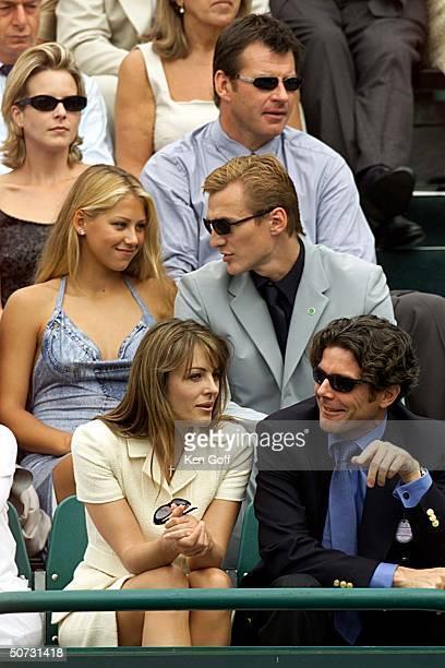 Golfer Nick Faldo tennis player Anna Kournikova and boyfriend ice hockey professional Sergei Federov film star Liz Hurley and friend watching charity...