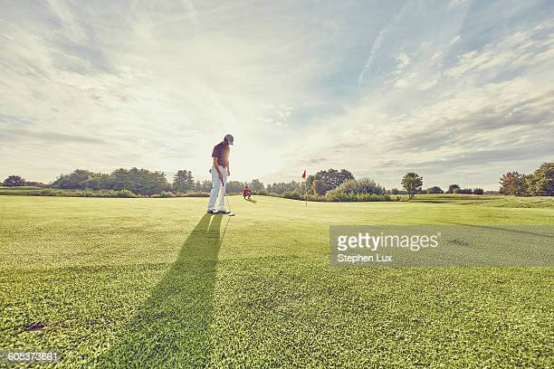 Golfer on course, Korschenbroich, Dusseldorf, Germany