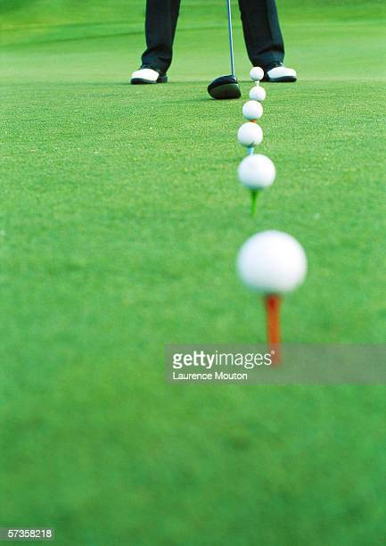 golfer on driving range, low section - driving range stock pictures, royalty-free photos & images