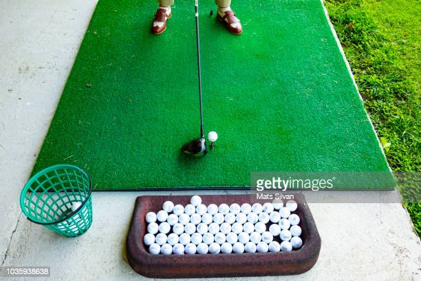 golfer on golf driving range with driver golf club - driving range stock pictures, royalty-free photos & images