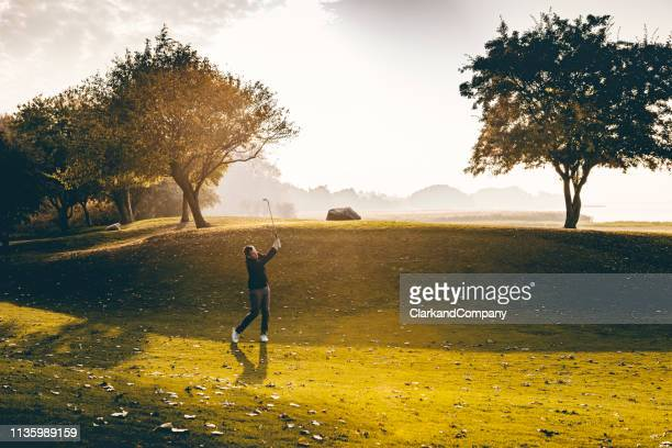 golfer on the fairway - golfer stock pictures, royalty-free photos & images