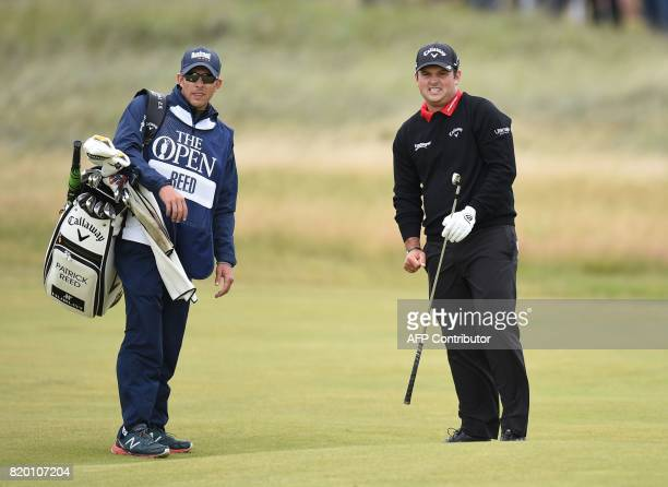 US golfer Patrick Reed and his caddie Kessler Karain wait on the 8th fairway during his second round on day two of the Open Golf Championship at...