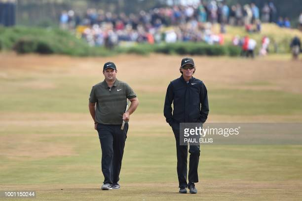 US golfer Patrick Reed and his coach Kevin Kirk walk up the 9th fairway during a practice round at The 147th Open golf Championship at Carnoustie...