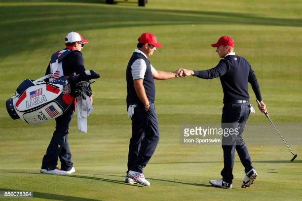 USA golfer Patrick Reed and Jordan Spieth fist bump on the 4th hole during the third round of the Presidents Cup at Liberty National Golf Club on...