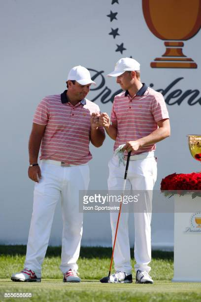 USA golfer Patrick Reed and Jordan Spieth give each other a fist bump before teeing off on the first hole during the second round of the Presidents...