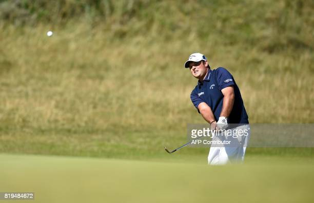 US golfer Patrick Reed chips onto the 6th green during his opening round on the first day of the Open Golf Championship at Royal Birkdale golf course...