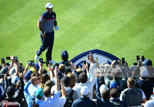 US golfer Patrick Reed gestures to the crowd during a practice session ahead of the 42nd Ryder Cup at Le Golf National Course at...