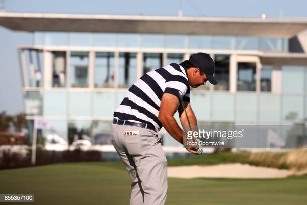 USA golfer Patrick Reed hits a shot on the 14th hole during the first round of the Presidents Cup on September 28 at Liberty National Golf Club in...