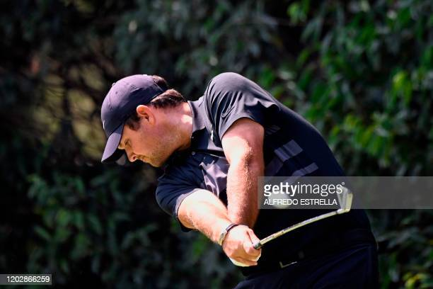 US golfer Patrick Reed hits a tee shot from the 2nd hole during the third round of the World Golf Championship at Chapultepec's Golf Club in Mexico...